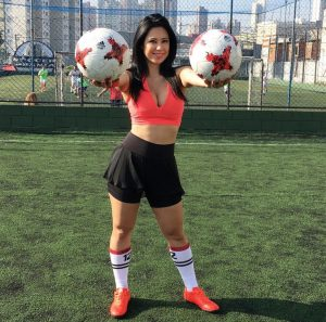 Soccer and stilettos! Freestyle footballer Racquel freestyle shows off her fancy footwork… in heels and a VERY tight mini dress