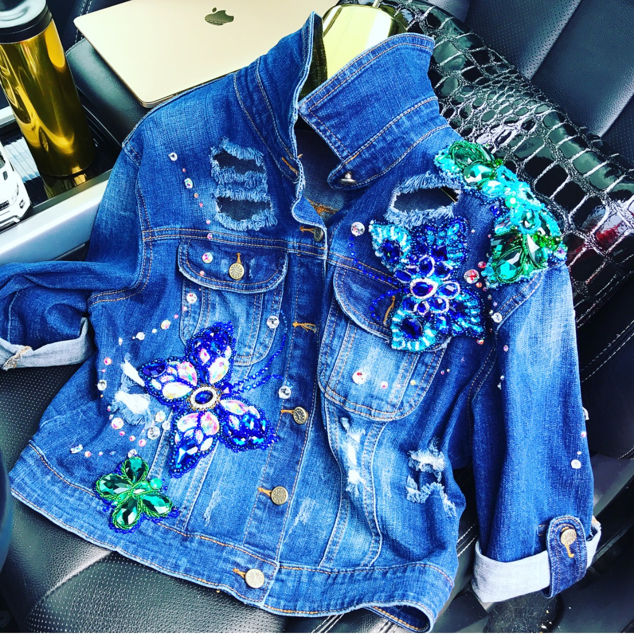 Heavily embellished denim jacket