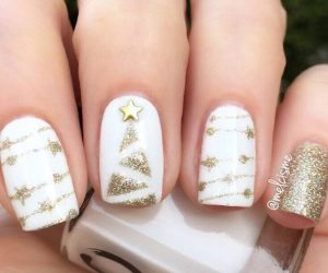 This white and Gold Christmas nail idea will have you running to the spa