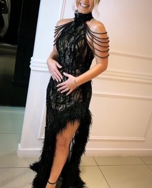 Black beaded evening frock with ostrich feather detail