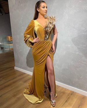 Ostrich feather detail gold dress