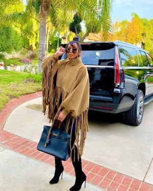 JC in poncho and boot set
