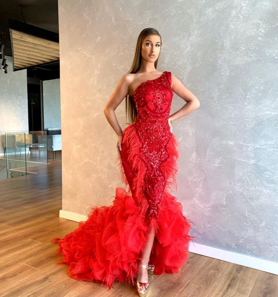 Super Gorgeous embellished red frills and ostrich feather dress