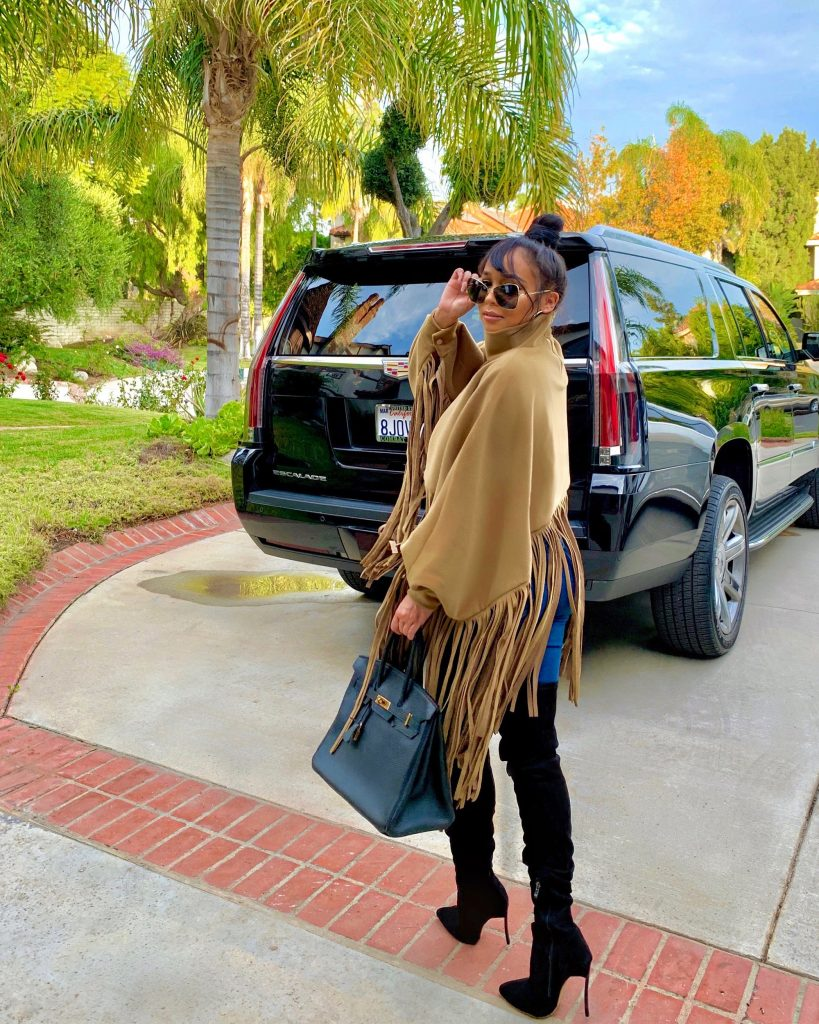 JC in Casual brown fringe cape look