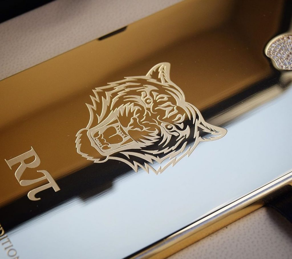 Bespoke gold iphone with stone engraving