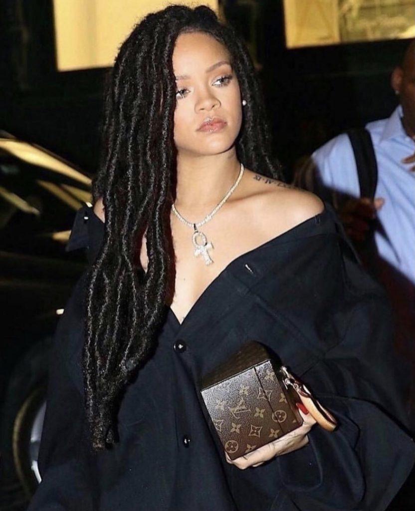 Rihanna in a black long locks braid look