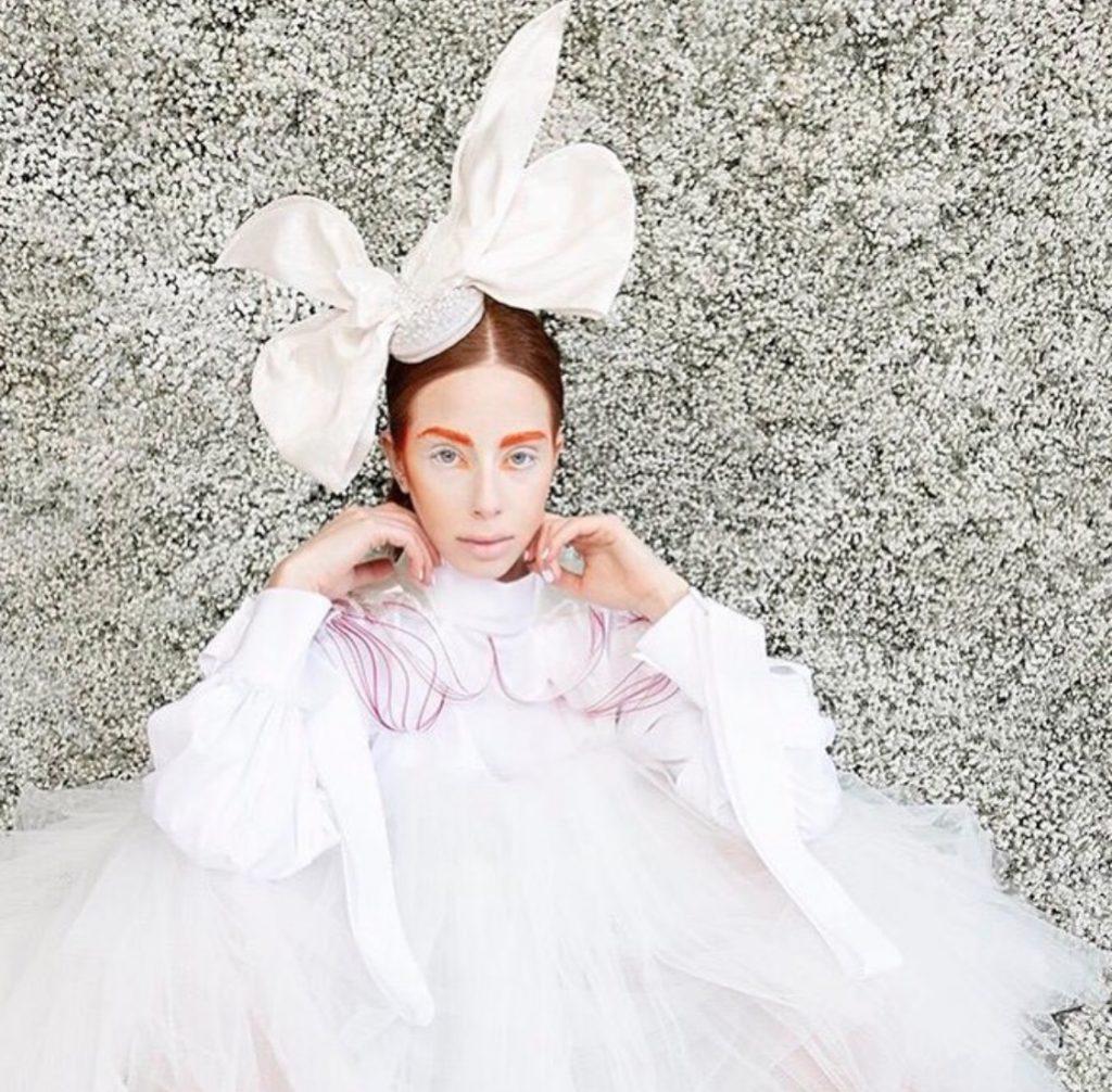 Exquisite extravagant white couture bow hat