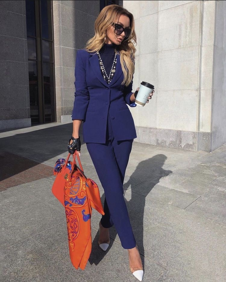 Victoria fox in a dark blue pant suit outfit