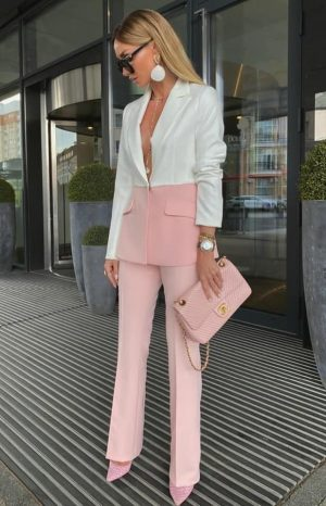 Victoria fox in a pink and white pant suit outfit