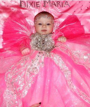 Extra opulent Pink embellished kids couture dress